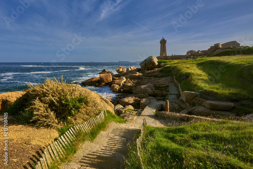 Foto Murales Lighthouse among the red rocks of Perros-Guirec, France