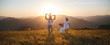 Leinwandbild Motiv Happy family: mother, father, children son and daughter on sunset