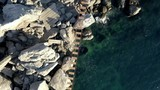 aerial view of rope bridge between the rocks over the sea and danger waves and stones - 213722887