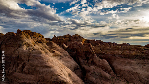 Foto Spatwand Chocoladebruin Aerial view of Lake Powell near Navjo Mountain, San Juan River in Glen Canyon with colorful buttes, skies and water