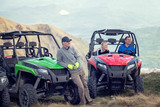 Friends driving off-road with quad bike or ATV and UTV vehicles - 213735432