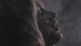 Attractive blonde girl in white thick smoke cloud, closeup portrait shot in slowmotion, dark background, 150fps - 213743067