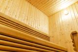 Interior of Finnish sauna. Classic wooden sauna. Finnish bathroom. Wooden sauna cabin. Wooden room. Sauna steam.. - 213748207