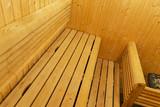 Interior of Finnish sauna. Classic wooden sauna. Finnish bathroom. Wooden sauna cabin. Wooden room. Sauna steam.. - 213748219