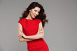 Beautiful woman in a red dress. Fashionable business woman.