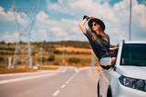 woman posing on car window