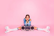 Leinwanddruck Bild - Full-size photo of excited beautiful lovely girl sitting on twine in rollers with a boombox isolated on pink vivid background