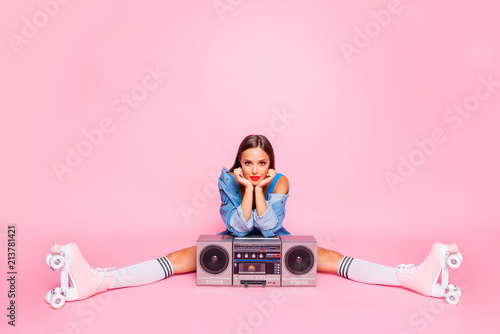 Leinwanddruck Bild Full-size photo of excited beautiful lovely girl sitting on twine in rollers with a boombox isolated on pink vivid background