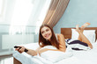 woman relaxing in hotel room and looking tv