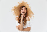 Portrait closeup of happy young woman 20s wearing big straw hat posing on camera with lovely smile, isolated over white background
