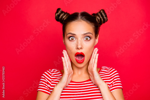 Leinwandbild Motiv Say what? Close up portrait of  shocked brunette girl with wide open mouth and big eyes hold palms near face isolated on red vivid background