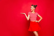 Leinwandbild Motiv Recommend concept. Portrait of lovely pretty brunette lady holding and demonstrate invisible product on hand isolated on red background copyspace