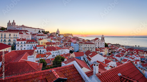A view of Lisbon's rooftops at sunrise from the Miradouro das Portas do Sol - Lisbon, Portugal  - 213786646