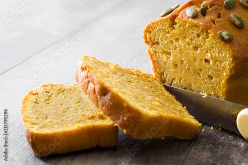 Leinwanddruck Bild Homemade pumpkin bread on wooden table.