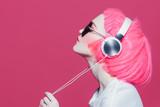 girl enjoys music - 213805044