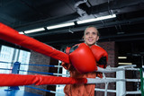 Free time. Beaming athletic woman training in boxing ring while having free time from work - 213814274