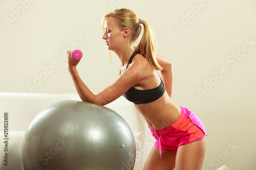 Fotobehang Fitness Woman with gym ball and dumbbell doing exercise