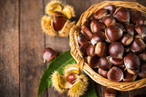 Fresh chestnuts in the basket  - 213839805