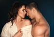 Quadro Young sexy hot couple in love hugging and kissing. Beautiful woman and handsome muscular man close to each other in erotic pose.
