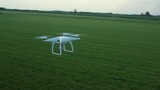 View Of Drone Hovering In The Field - 213844887