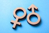 Gender symbols of man and woman of tree on blue - 213871042