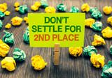 Word writing text Don t not Settle For 2Nd Place. Business concept for you can be the first dont stop here Clothespin holding yellow note paper crumpled papers several tries mistakes. - 213876635