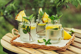 Refreshing chilled lemon water on the garden table.