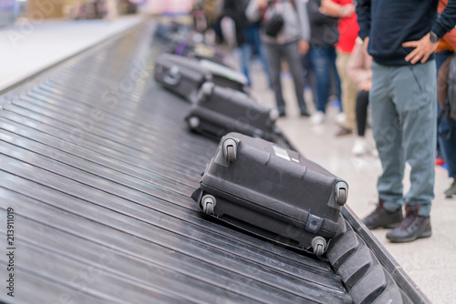 Foto Murales Suitcase or luggage with conveyor belt in the airport