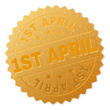 1ST APRIL gold stamp seal. Vector golden medal of 1ST APRIL text. Text labels are placed between parallel lines and on circle. Golden surface has metallic texture. - 213911234