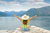 girl with thumbs up on summer vacation Kotor bay Montenegro - 213915048