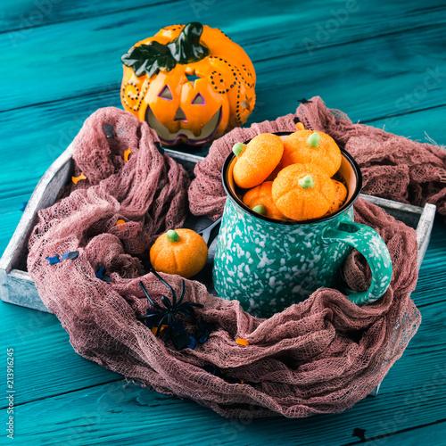 Plexiglas Chocolade Hot cocoa with pumpkin marshmallows on dark styled Halloween background
