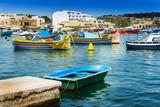 Traditional boats at Marsaxlokk Harbor in Malta - 213918802