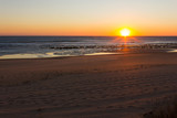 Sun rays hitting on calm ocean at sunset in Zahora empty beach, Andalusia. Fabulous twilight by the sea in Cadiz. Summer vacation, travel holidays concepts - 213920221