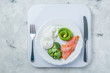 Ketogenic food concept - plate with keto food on weights
