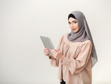 Islam businesswoman with tablet computer - 213929681