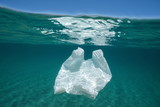 Underwater pollution a plastic bag adrift in the Mediterranean sea below water surface, Almeria, Andalusia, Spain - 213930652