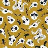 Vector seamless pattern with animal skulls. Halloween or Day of the dead design for fabric with cute skulls and horns. - 213932271