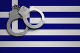 Greece flag  and police handcuffs. The concept of crime and offenses in the country - 213933686