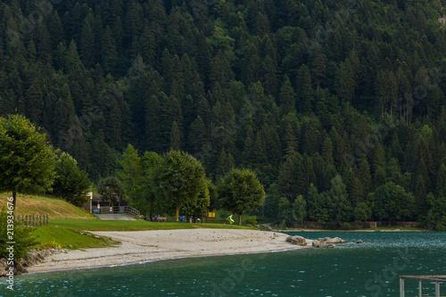 Fotobehang Zwart Lake Molveno, a wonderful lake, in western Trentino Alto Adige, Italy, at the foot of the Brenta Dolomites. The lake given the name to the polular tourist destination.