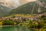 Lake Molveno, a wonderful lake, in western Trentino Alto Adige, Italy, at the foot of the Brenta Dolomites. The lake given the name to the polular tourist destination. - 213935217