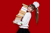 Little girl hold many books isolated on red. Concept of knowledge or school. Book lover - 213936054