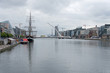 Old sailing ship on River Liffey, Samuel Beckett Bridge and the CCD, Dublin, Ireland - 213938005