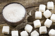 Powder and cubes of refined sugar