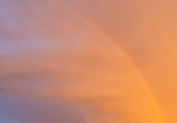 Rainbow in the sky at sunset as background