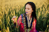 Tender indian girl in saree, with violet lips make up posed at field in sunset. Fashionable india model. - 213944409