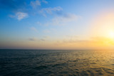 Summer sunset seascape with wide horizon of the sky and the sea - 213964489