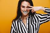 Smiling female model winking - 213966408