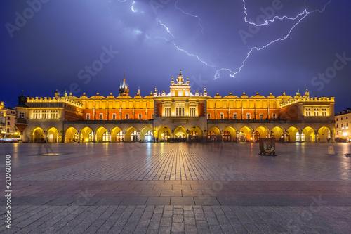 Fotobehang Krakau Thunderstorm on the Main Square of Krakow at night, Poland