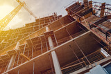Building construction site with scaffolding - 213975218