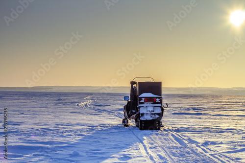snowy road snowmobile - 213986236